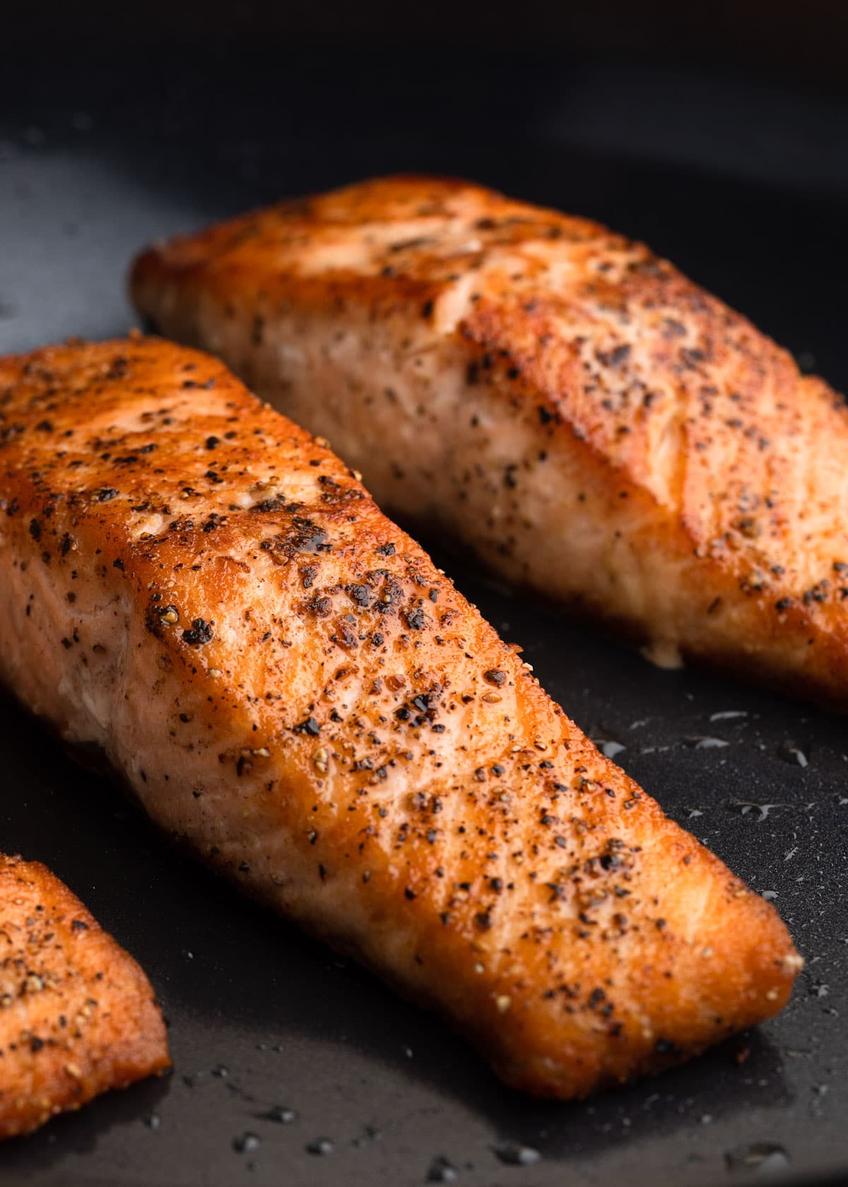 pan seared salmon fillets in a nonstick pan
