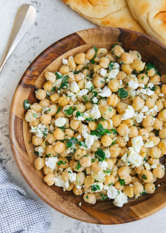 chickpea salad recipe with feta and lemon vinaigrette in a wood bowl