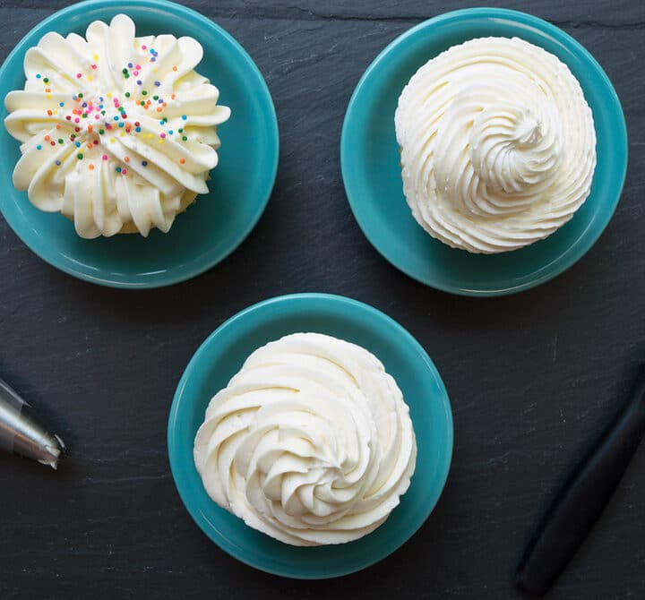 overhead of 3 cupcakes with 3 different types of vanilla frosting