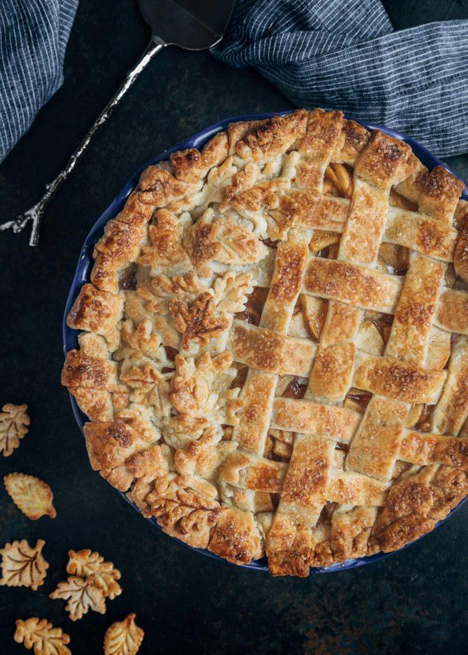 baked lattice apple pie with leaf crust cutouts