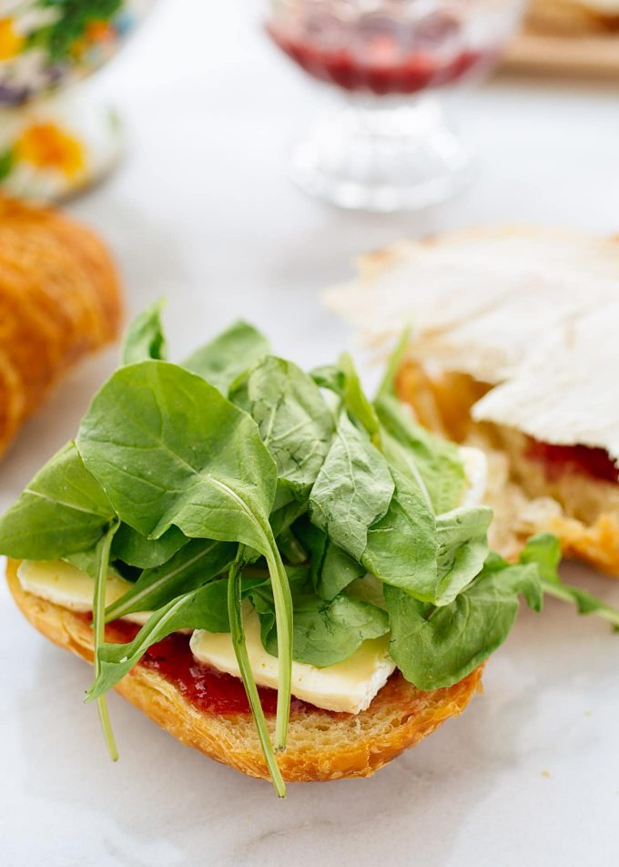closeup of baby arugula leaves on a turkey croissant panini