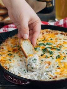 warm crab artichoke dip with crostini dipper