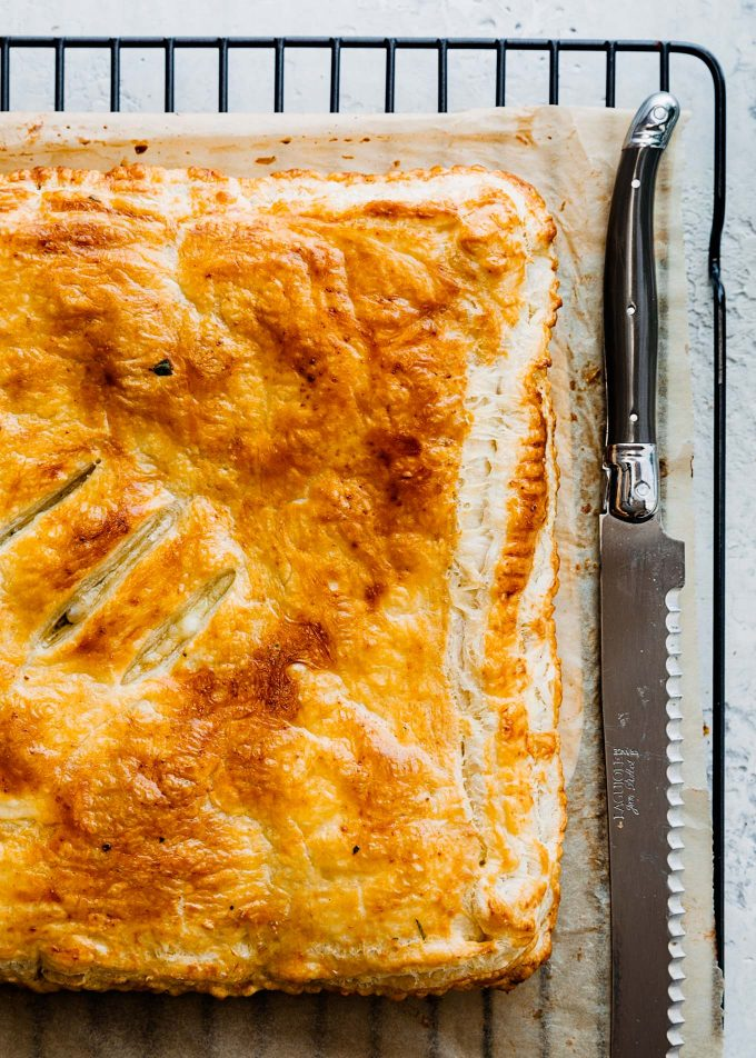baked ham and cheese slab pie on a cooling rack
