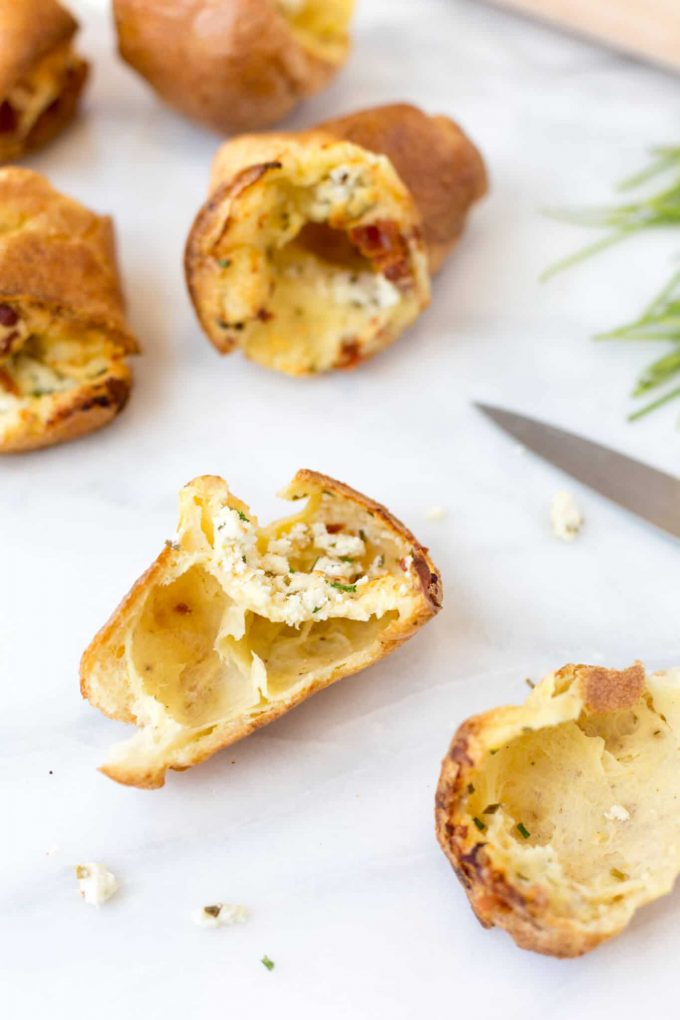 hollow goat cheese popovers with bacon, cut in half