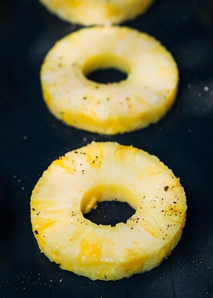 sliced pineapple on a nonstick grill mat