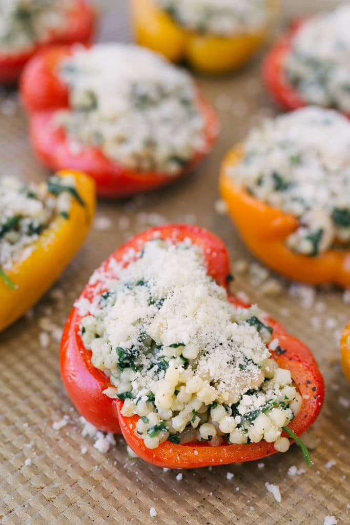 couscous stuffed peppers topped with parmesan