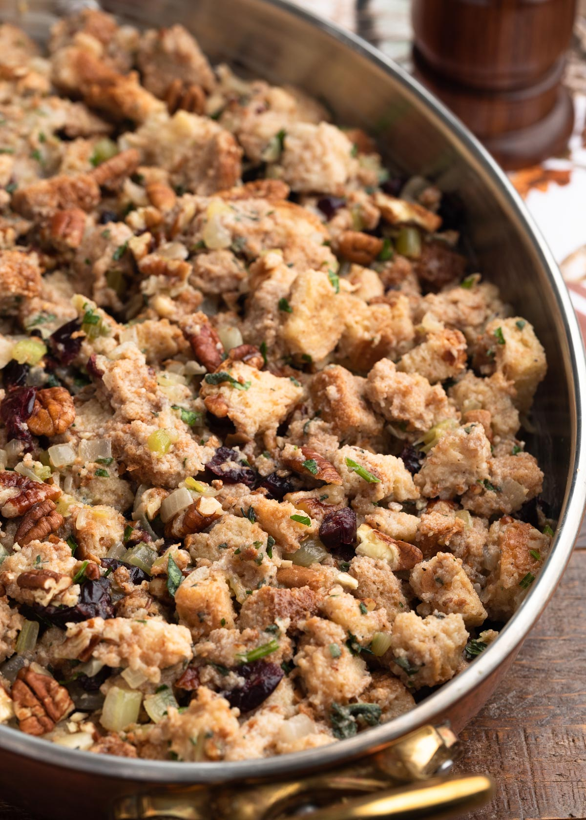 assembled cranberry stuffing in a tin-lined copper gratin pan before baking