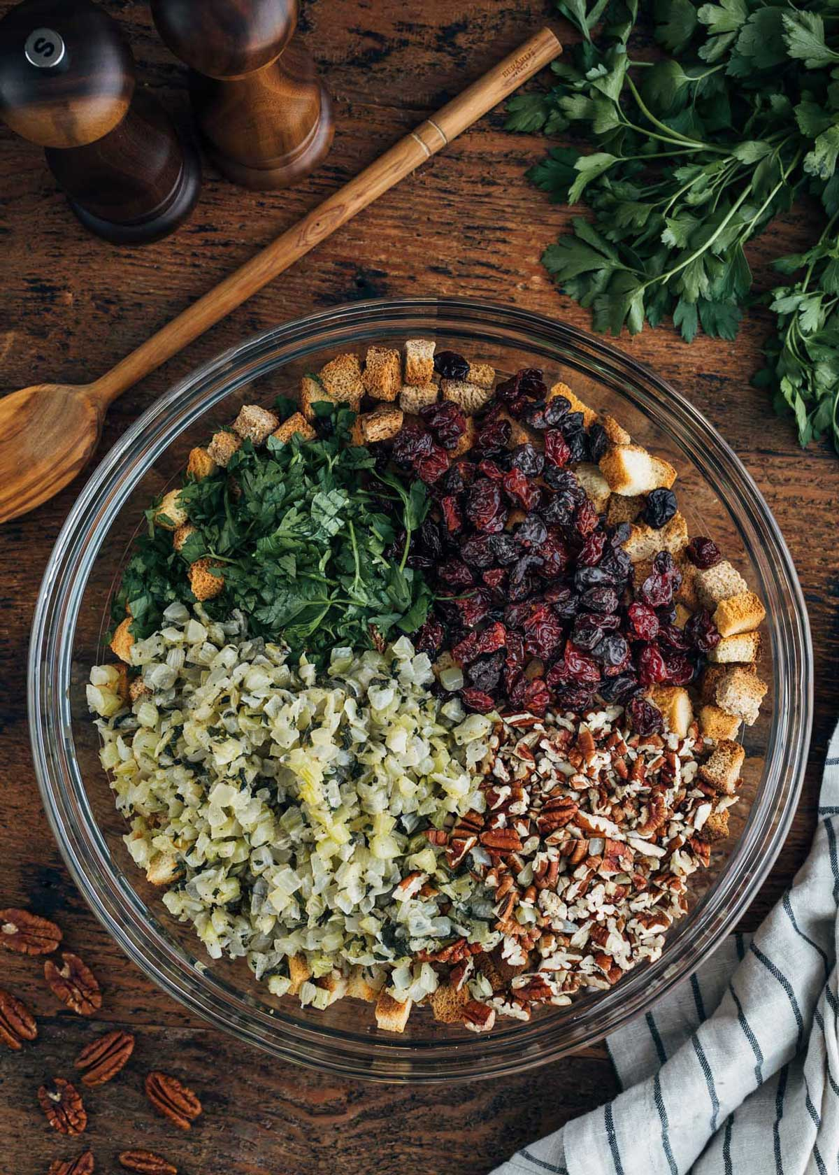dried cranberries, pecans, croutons, and sauteed onions and celery in a large glass bowl