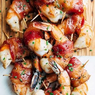 bourbon glazed bacon wrapped shrimp on a serving board