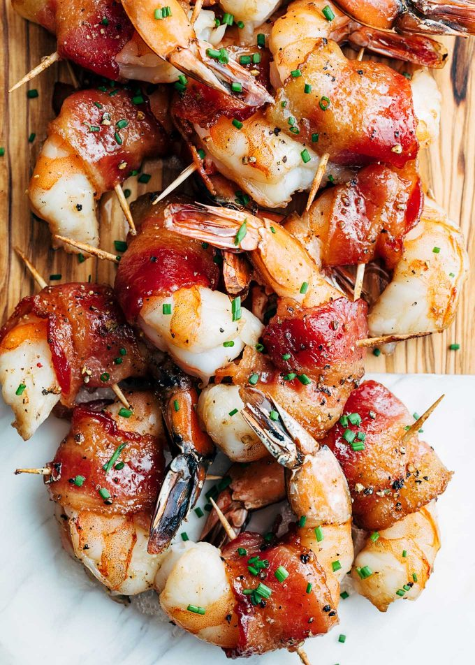 bourbon glazed bacon-wrapped shrimp on a serving board