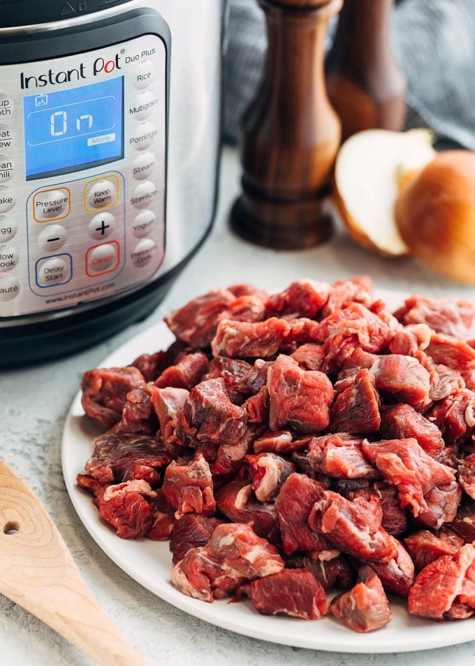 beef chuck cubes in front of the Instant Pot for Texas Red Chili