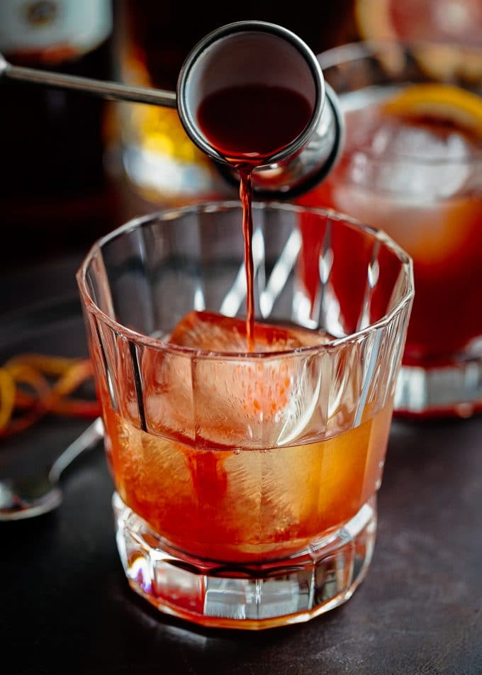 pouring campari for blood orange boulevardier recipe