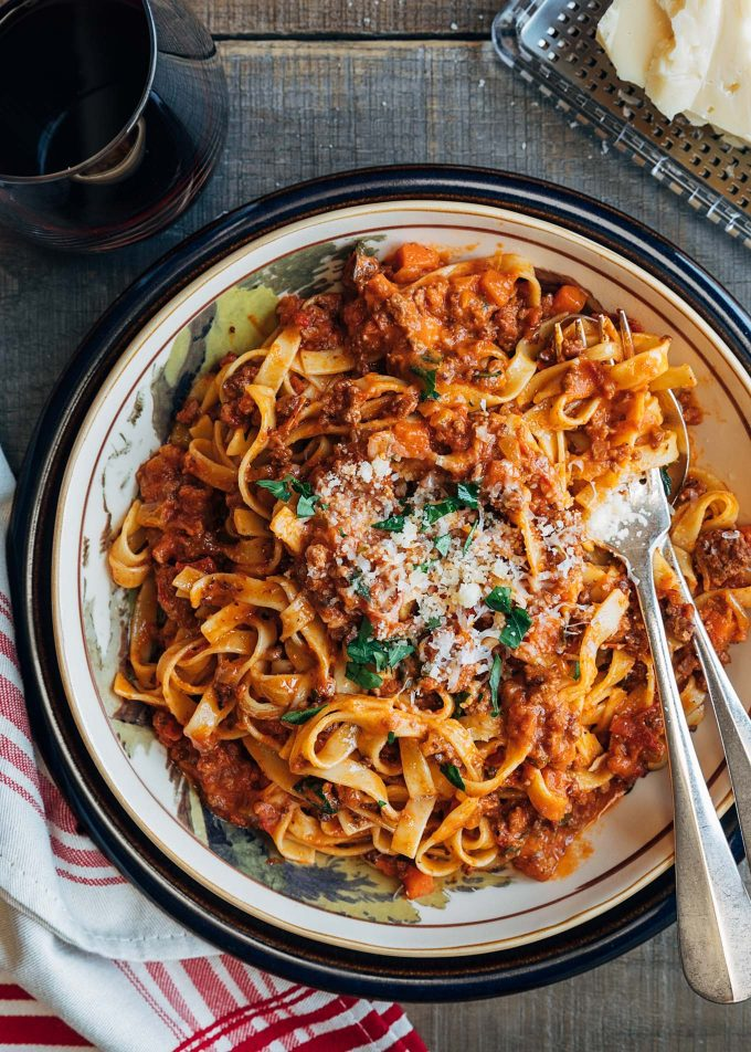 ragu bolognese with tagliatelle pasta and grated parmigano reggiano