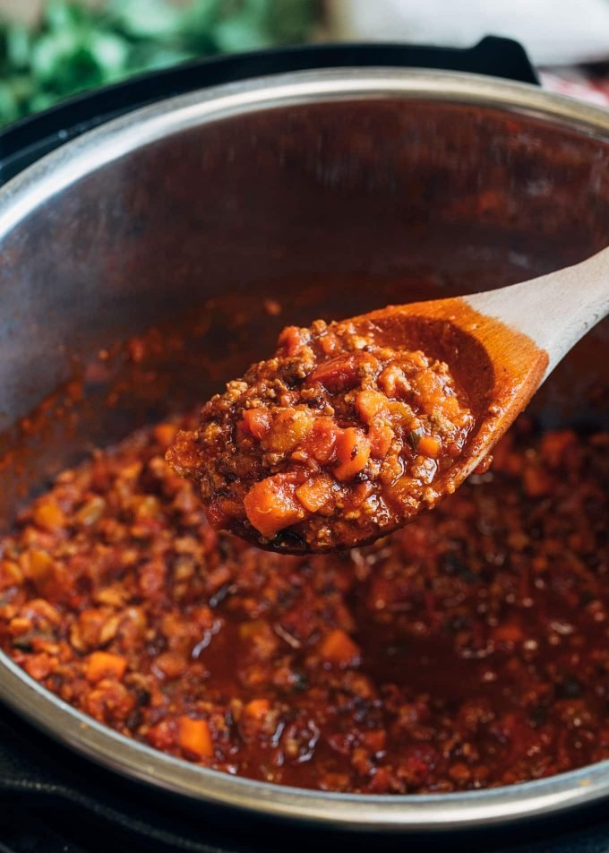cooked instant pot bolognese on a spoon