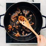 crisped bacon in a Staub cast iron pot