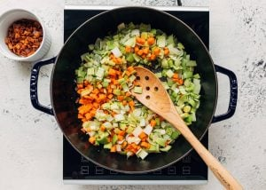 sautéing carrots, celery, and leeks in a Staub pot