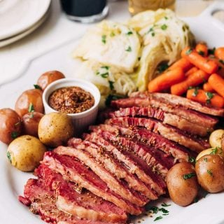 instant pot corned beef served with cabbage, carrots, and potatoes