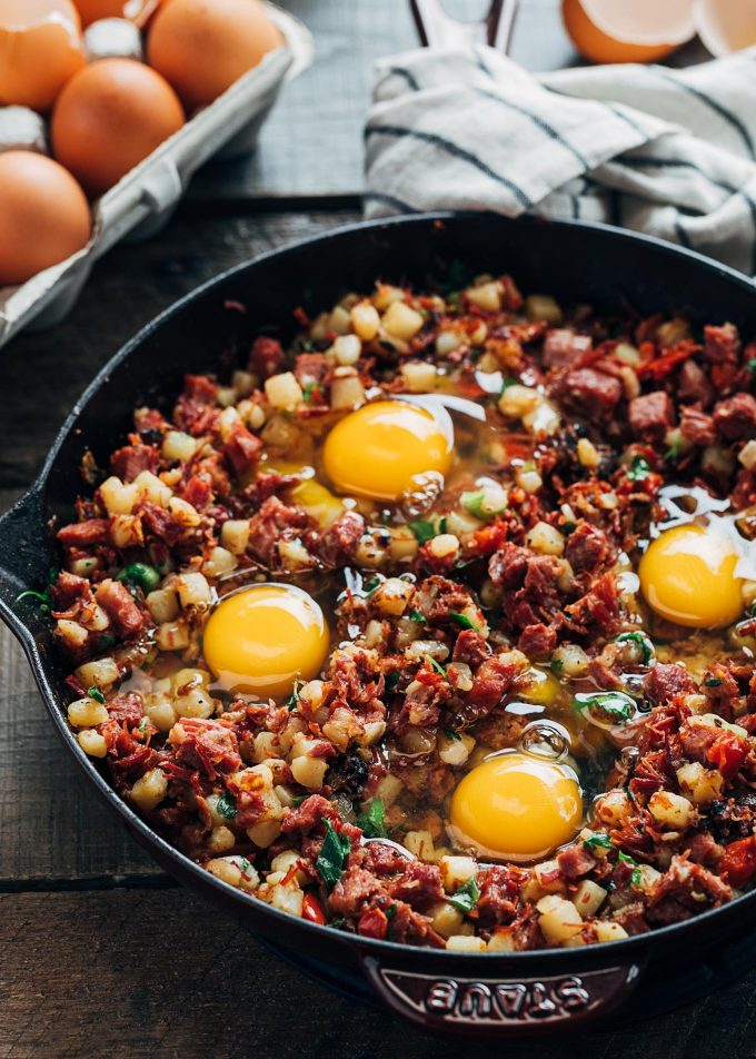 raw eggs in corned beef hash breakfast skillet