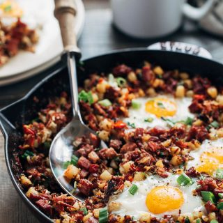 corned beef hash and eggs in a cast iron skillet
