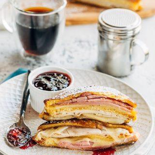 fried monte cristo sandwich with turkey, ham, and swiss