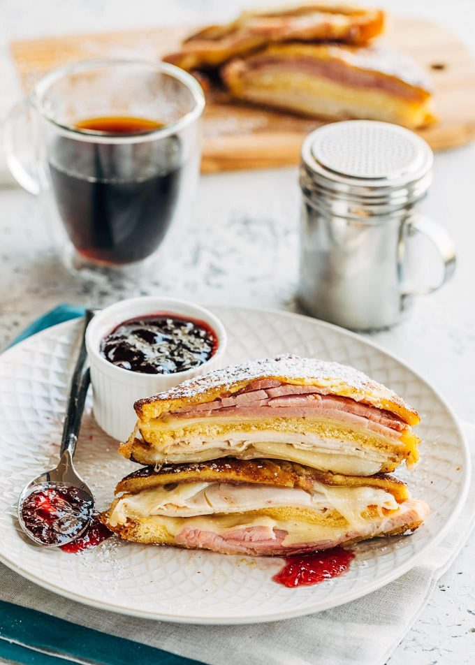 fried monte cristo sandwich recipe with turkey, ham, and swiss on a plate
