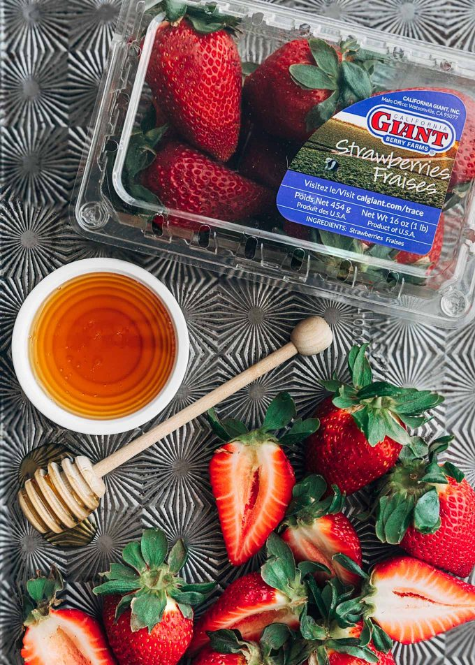 california giant berry farms strawberries on a roasting pan with honey {sponsored}