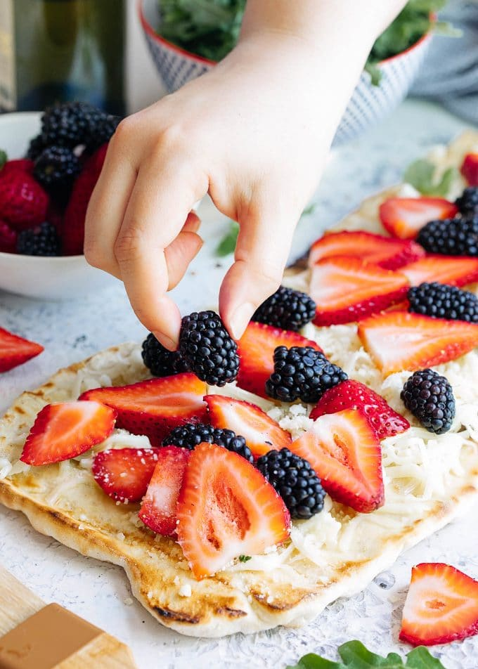 placing summer berries onto grilled flatbread {sponsored}