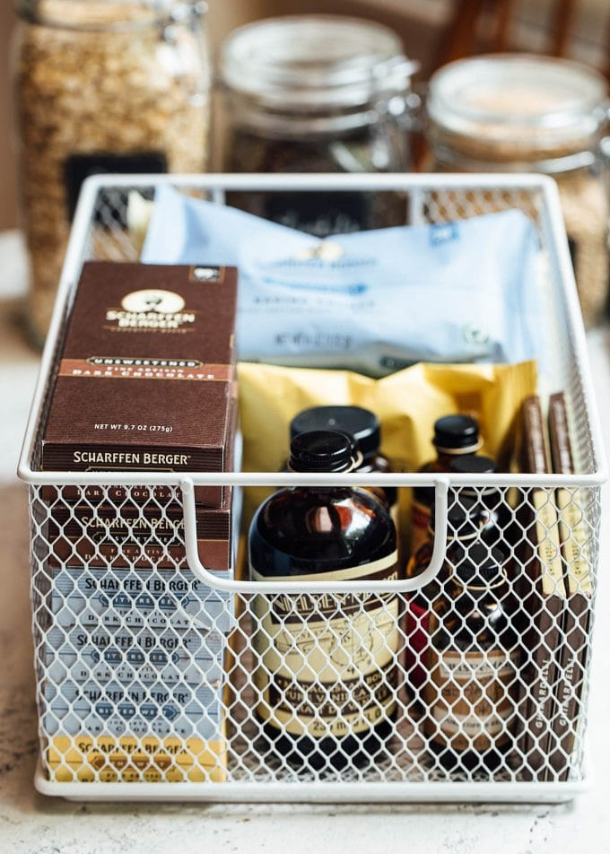 wire baskets with baking supplies for pantry organization