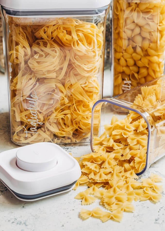 dried pasta in OXO pop top plastic canisters