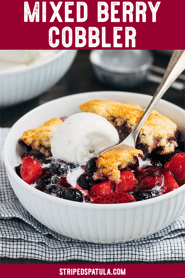 This easy Mixed Berry Cobbler with Cornbread Biscuit Topping is a perfect summer dessert to make with your favorite fresh berries! The light and fluffy cornbread biscuits, brushed with honey butter, are a fun twist on a classic cobbler topping. Serve warm with vanilla ice cream or whipped cream! #berries #cobbler #strawberries #blueberries #dessert