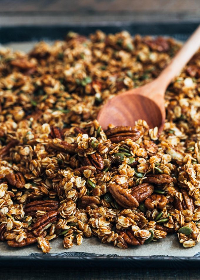 unbaked pumpkin granola with pecans on a sheet pan