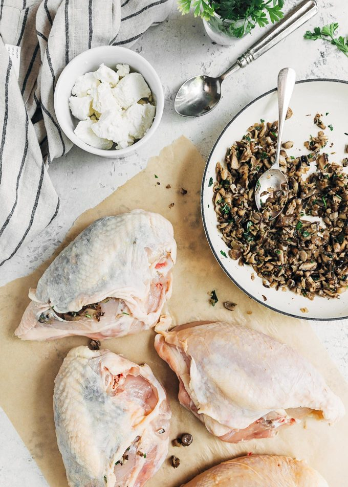 stuffing bone-in chicken breasts with mushrooms and goat cheese