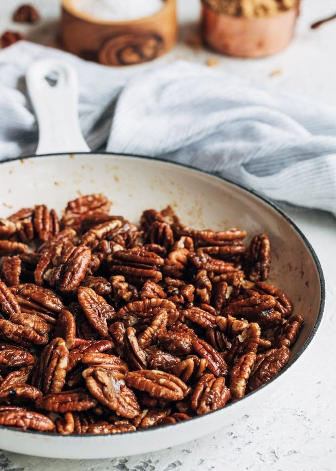 caramelized pecans in a white saute pan