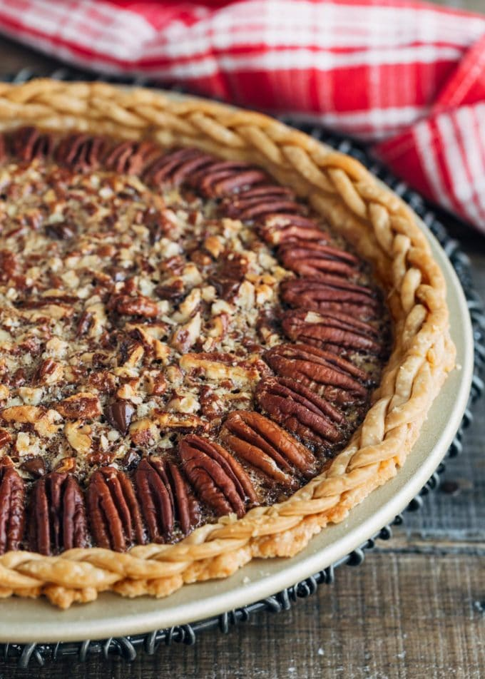 baked chocolate bourbon pecan pie on a cooling rack
