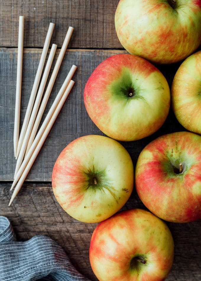 honeycrisp apples on a board with dipping sticks