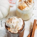pumpkin hot chocolate in mugs with brown sugar whipped cream