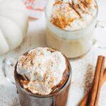 pumpkin hot chocolate in mugs with brown sugar whipped cream