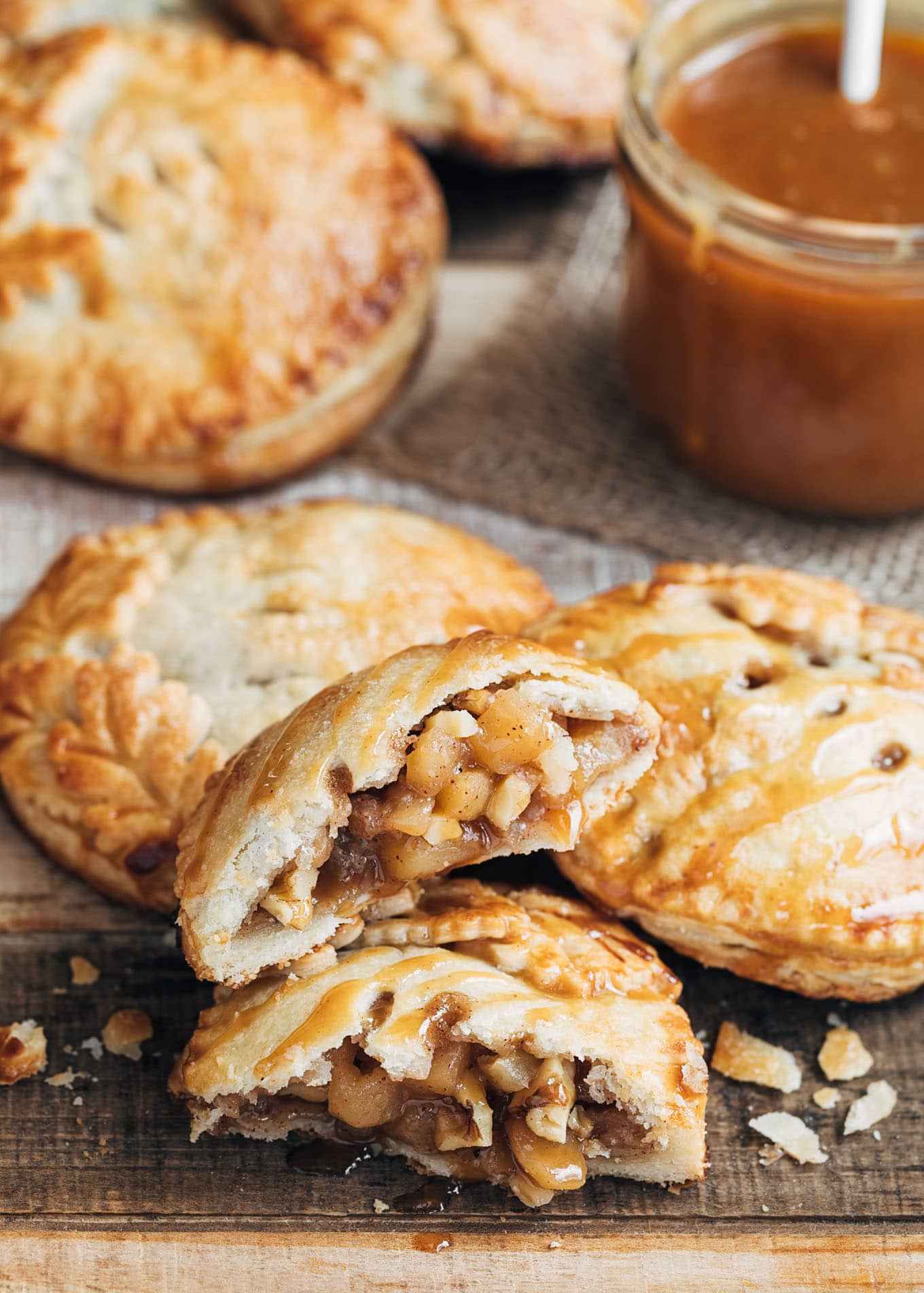 caramel apple hand pies drizzled with caramel sauce