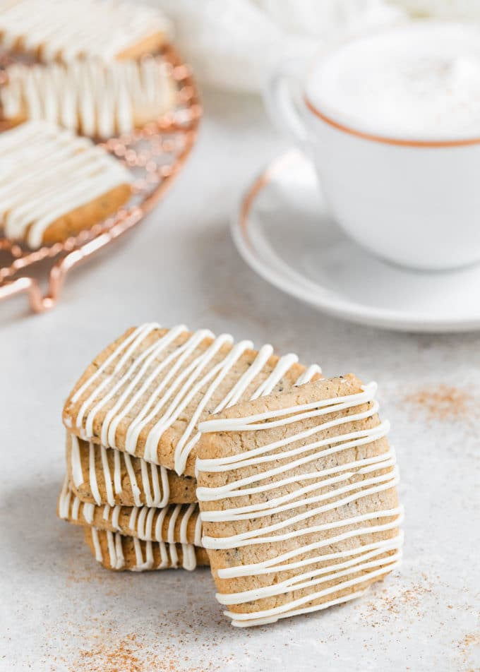 stack of chai shortbread cookies with a chai latte