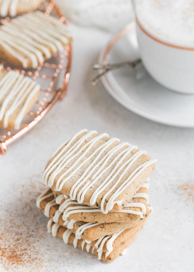 stack of chai shortbread cookies next to a chai tea latte