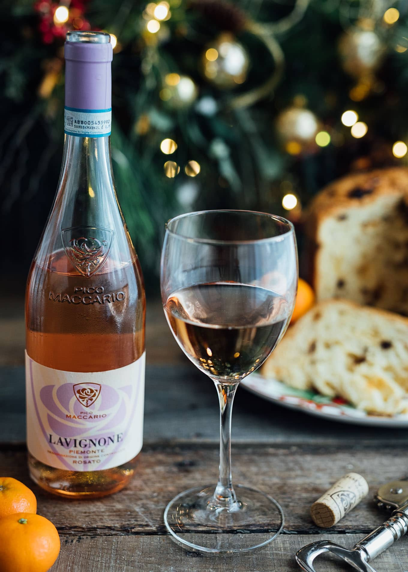 glass of Pico Maccario Barbera 'Lavignone' rose wine with a poured glass and panettone