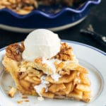 slice of homemade apple pie with a scoop of vanilla ice cream