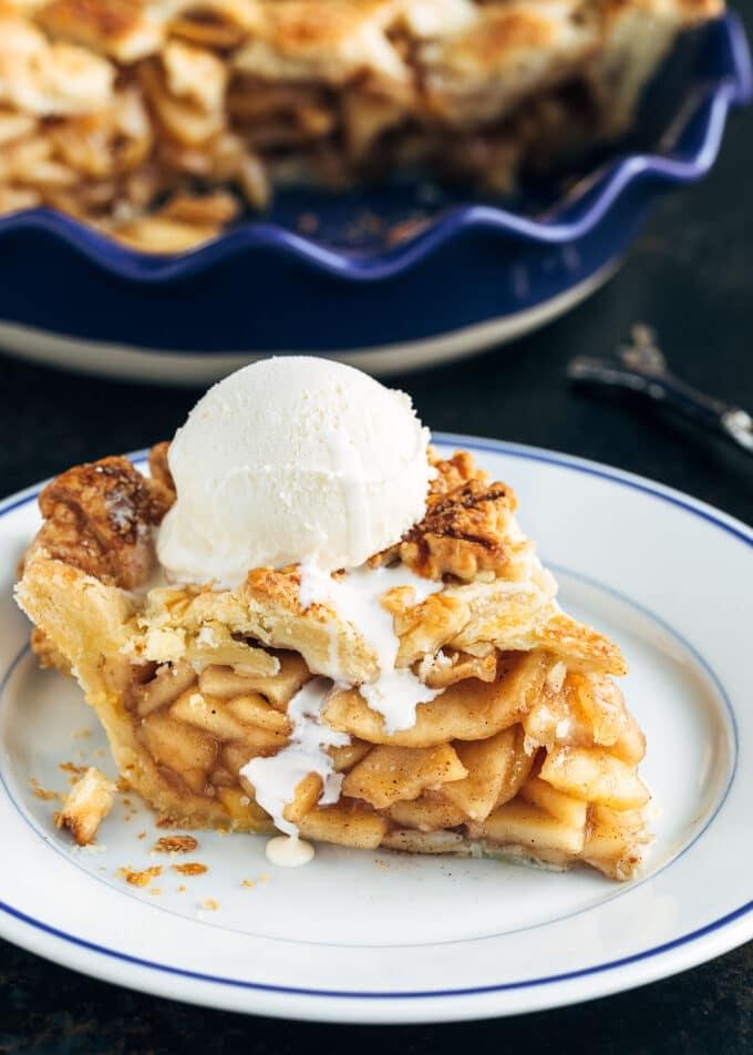 slice of homemade apple pie with a scoop of vanilla ice cream