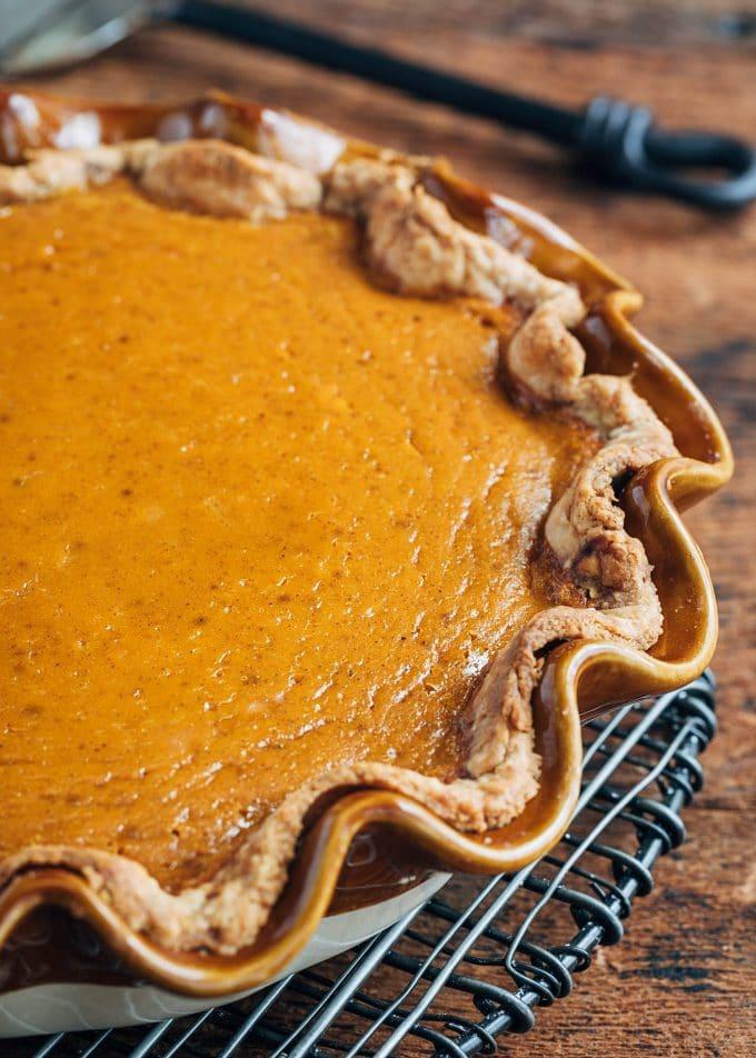 baked pumpkin pie on a cooling rack