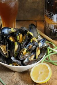 beer steamed mussels with garlic scapes from Earth Food and Fire