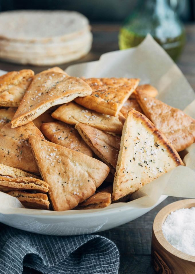 baked homemade pita chips in a serving bowl