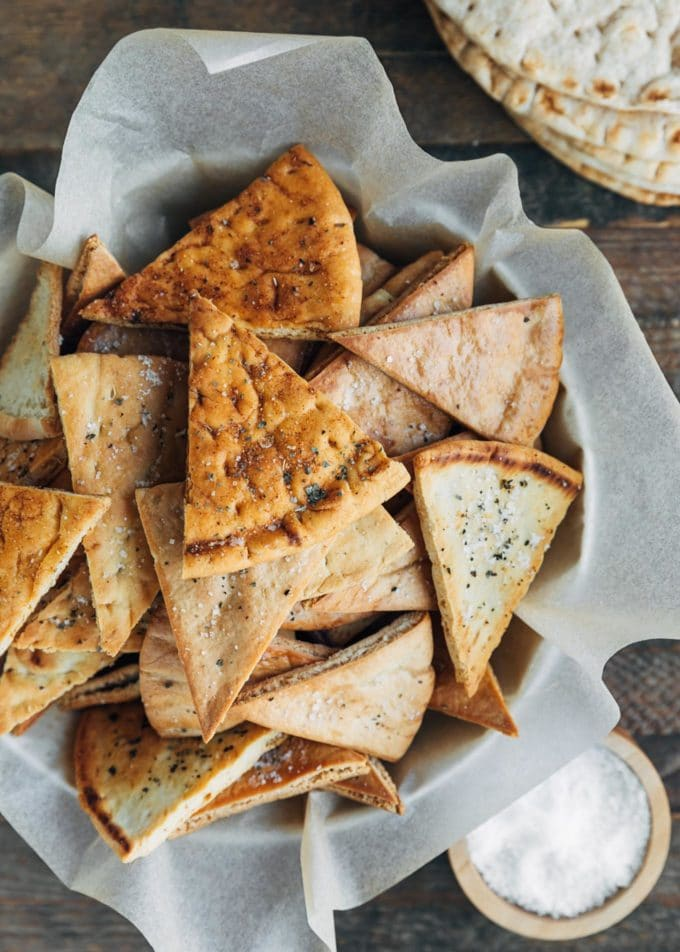 overhead of baked pita chips in a serving bowl