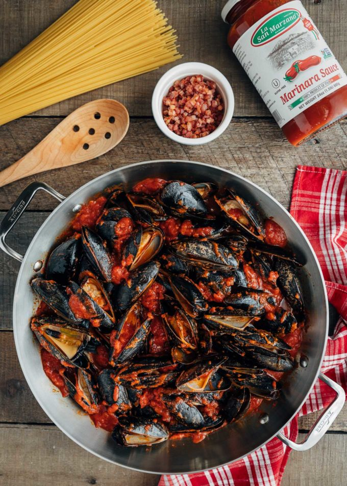 mussels in La Regina di San Marzano tomato sauce in a pan {sponsored}