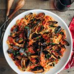mussels with pasta and tomato sauce in a white serving bowl {sponsored}