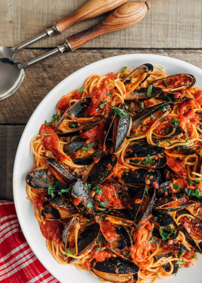 overhead view of pasta with mussels and san marzano tomato sauce in a white serving bowl {sponsored}